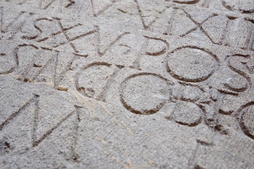 Large roman letters carved in stone